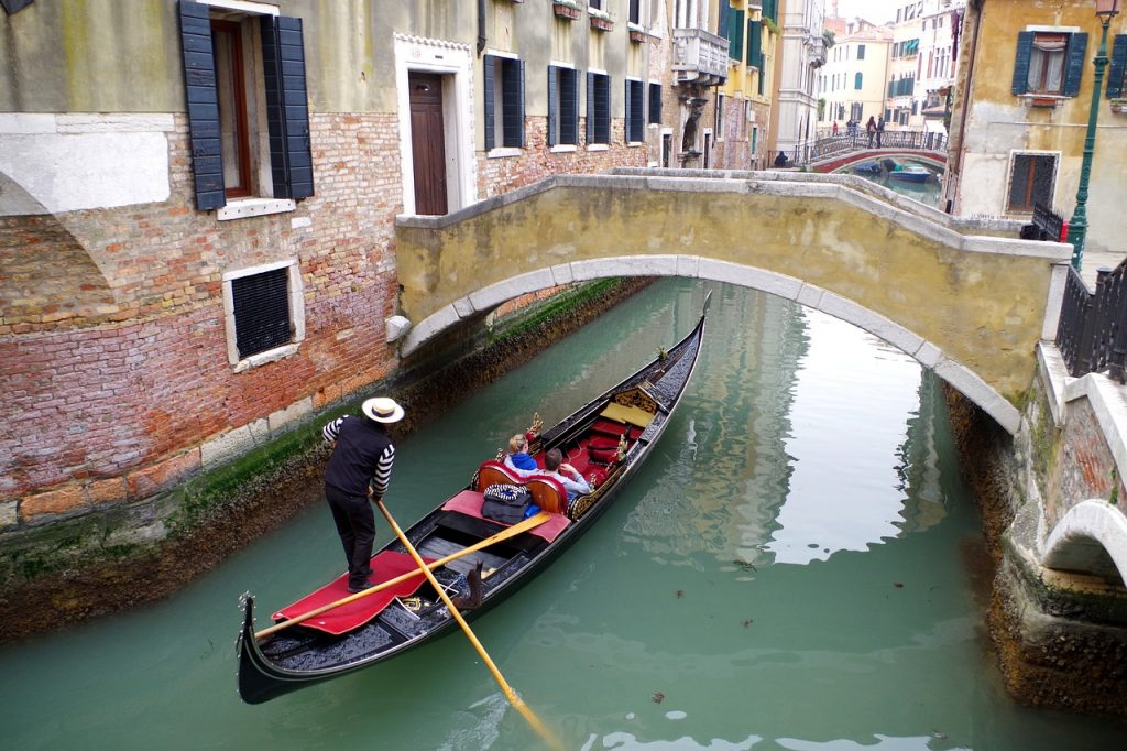 A gondola through Venice is one of the best ideas from the bucket list for couples.